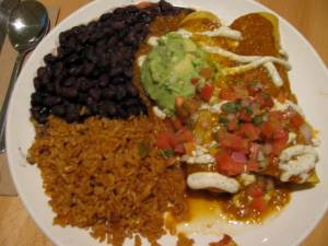 corn enchiladas, seasoned tempeh, salsa rojo, spanish rice, black beans, pico de gallo, tofu sour cream, guacamole