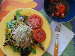 a great salad which we topped with homemade thousand island, and a side of cumin & nooch black beans with fresh tomato